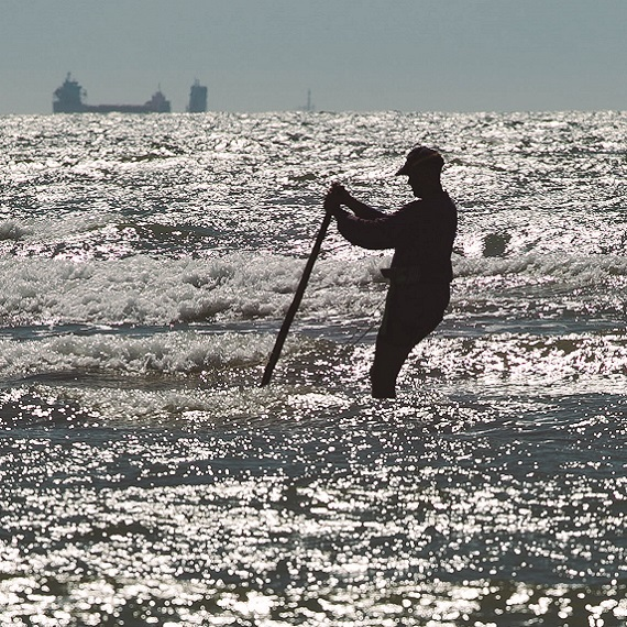 A fisherman working in the water